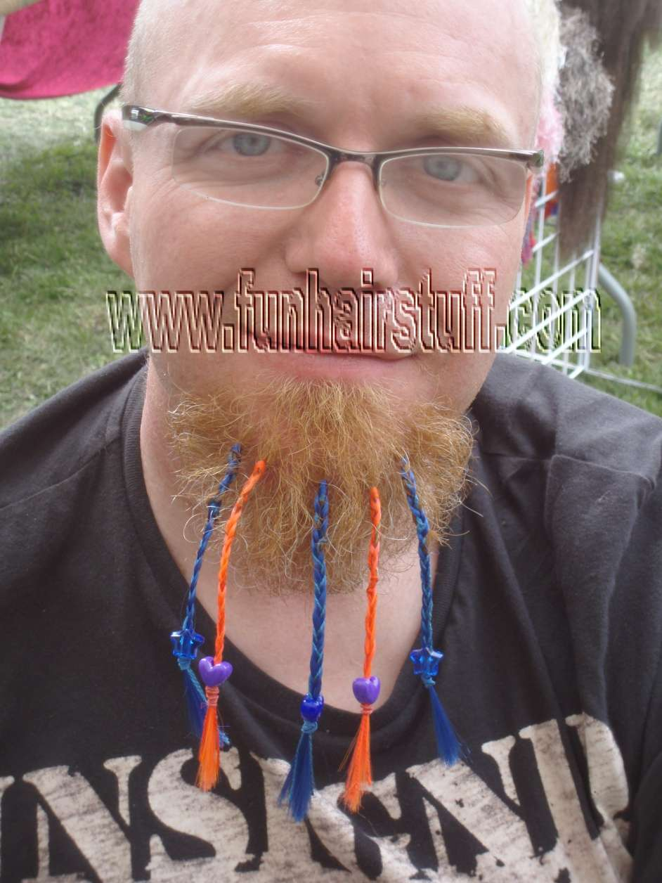 This Guy Asked Us To Braid His Beard Hair With Red And Black Synthetic Hair  To Make His Beard Much Longer There Were Only About Twenty Hairs There!