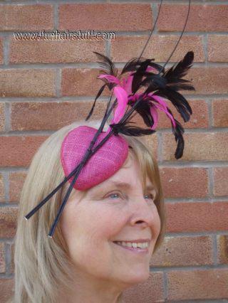 pink heart-shaped sinamay fascinator